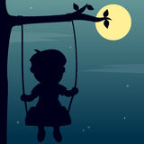 Boy Swinging in the Moonlight. Silhouette of a boy playing on a swing in the moonlight. Eps file available Royalty Free Stock Photography