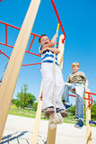 Boy swinging on the rope Royalty Free Stock Photos