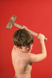 Boy swinging sledge hammer ver. Picture of a boy swinging sledge hammer Stock Images