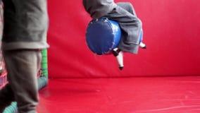 Boy swinging on a swing stock footage