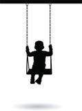 Boy swinging on a swing Stock Image