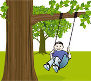 Boy swinging from tree Stock Image