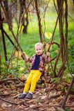 Boy swinging on a vine tree, plaid shirt Stock Images