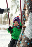 Boy swinging in winter park Stock Photography