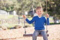 Boy at swings Royalty Free Stock Image