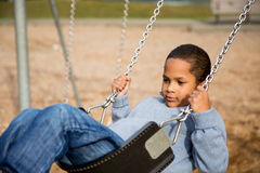 Boy on swings Royalty Free Stock Photo