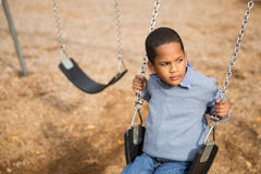 Boy on swings Royalty Free Stock Image