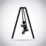 Boy on the swings Stock Photos