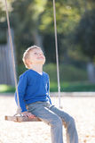Boy at swings Royalty Free Stock Images