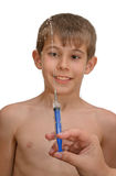 The boy and the syringe Royalty Free Stock Photos