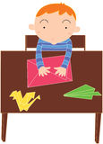 Boy at table Stock Images