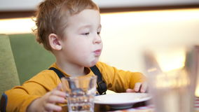 Boy at the table in cafe Stock Photography
