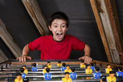 Boy at table football Stock Photos