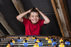 Boy at table football Stock Photography