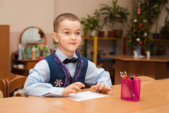 Boy at the table Stock Photos