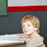 Boy at table in school Stock Photos