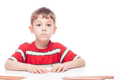 Boy at table Stock Photography