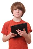 Boy with tablet. Young boy with tablet computer on white background Royalty Free Stock Image