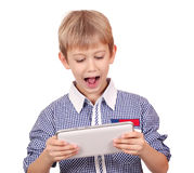 Boy with tablet Royalty Free Stock Image
