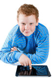 Boy with a tablet computer. On a white background Royalty Free Stock Photo