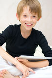 Boy with tablet computer Royalty Free Stock Photos
