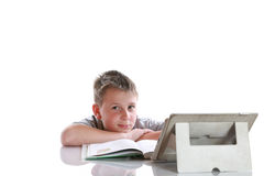 Boy with tablet computer makes lessons Stock Image