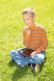 Boy with a Tablet Computer Royalty Free Stock Image