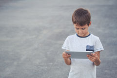 Boy with tablet computer. School, education, technology, leisure concept Royalty Free Stock Photo