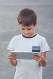 Boy with tablet computer. School, education, technology, leisure concept Royalty Free Stock Photography