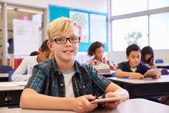 Boy with tablet in elementary school class, portrait Stock Photos