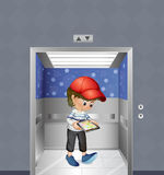 A boy with a tablet inside the elevator Stock Photo