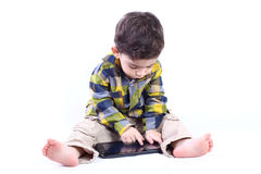 Boy with tablet. Little boy playing with tablet isolated on white Royalty Free Stock Photos