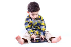 Boy with tablet. Little boy playing with tablet isolated on white Royalty Free Stock Images