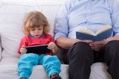Boy with tablet. Little smart boy learning how to use tablet Stock Images