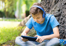 Boy with tablet Stock Images