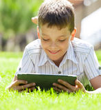 Boy with tablet Royalty Free Stock Photos