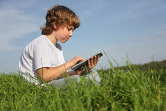 Boy with tablet pc. Outdoors Stock Photo