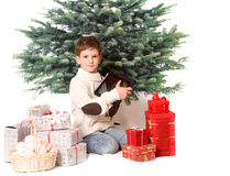 The boy with tablet PC and christmas presents Royalty Free Stock Photography