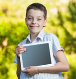 Boy with tablet pc Royalty Free Stock Photos