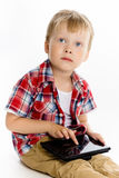 Boy with a Tablet PC. studio Stock Image