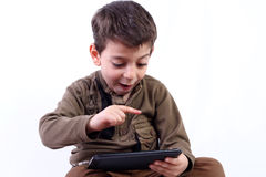 Boy with tablet. Boy playing game by tablet isolated on white Stock Photo