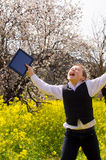 Boy with tablet rejoicing Stock Photos