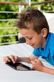 Boy with tablet during summer time Stock Photography
