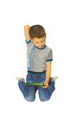 Boy with a tablet thinks sitting on his lap. Isolated image Stock Photo