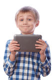Boy with tablet on a white Royalty Free Stock Photo