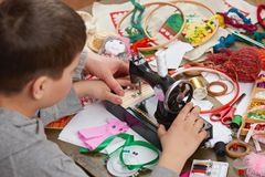 Boy tailor learns to sew, job training, handmade and handicraft concept Royalty Free Stock Image