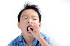 Boy take medicine Stock Image