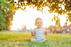 Boy take rest. Baby boy take rest in summer park Stock Photo
