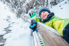 Boy take a selfie picture with his father in snow mountain canyo Royalty Free Stock Image