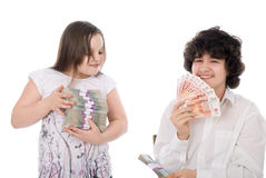 Boy takes away a batch of money from girl stock photo